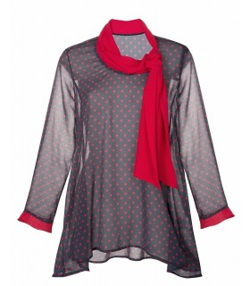 gray blouse with asymmetrical length, small red polka dots and large tie at the collar